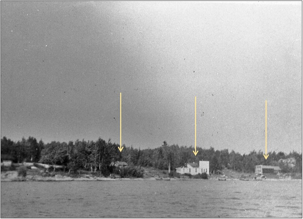 1910 Log Cabin (center-left), Chris Monson's trading post (center-right), and Jack Ryan's trading post (far right). Photo taken toward the northeast from Namakan Lake between 1913 and 1930, when Jack Ryan's trading post burns down (Source: VNP Collection).