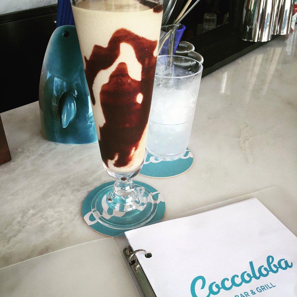 Coccoslide: absolut, crème de cacao, coconut, house cold brew coffee &cream