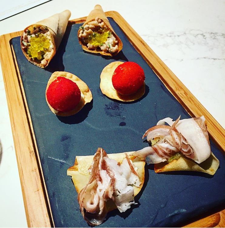 Amuse-bouche of tuna belly,quail egg & pork belly