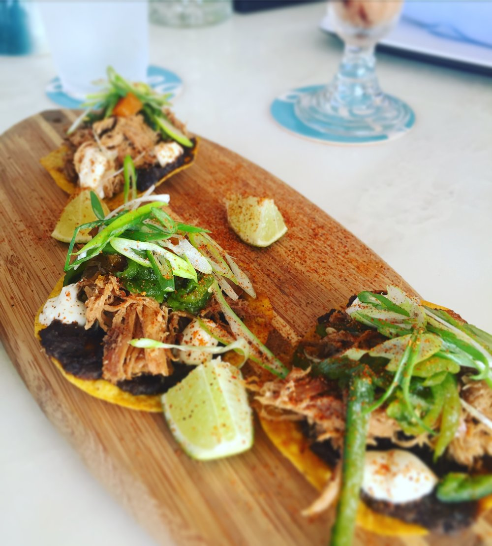 Pork Tostadas: roasted butternut squash, green chiles, black bean puree, lime, crema &scallions. Sprinkle the lime to add some more acidity to the dish.