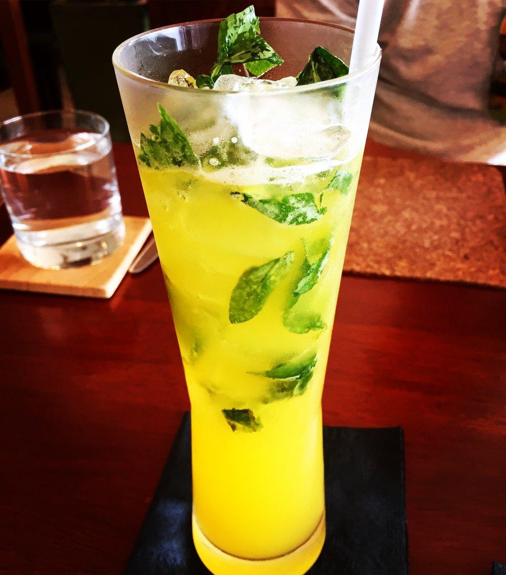 The refreshing Vietnamese Delight cocktail with domaine de canton, vodka, lemongrass tea, Thai basil, kalamansi juice & kaffir lime