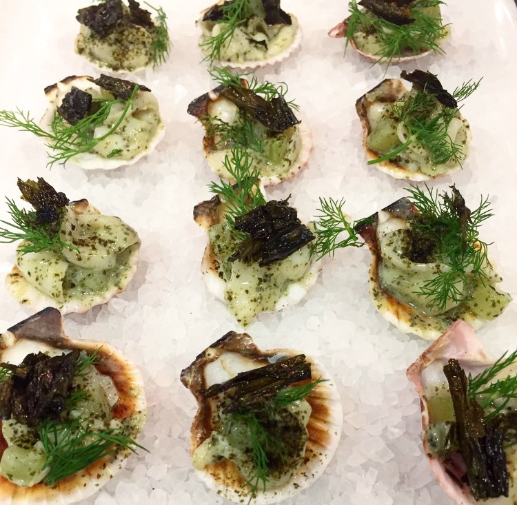 Conch salad canapé with pickled cucumber, dill & fried wakame.