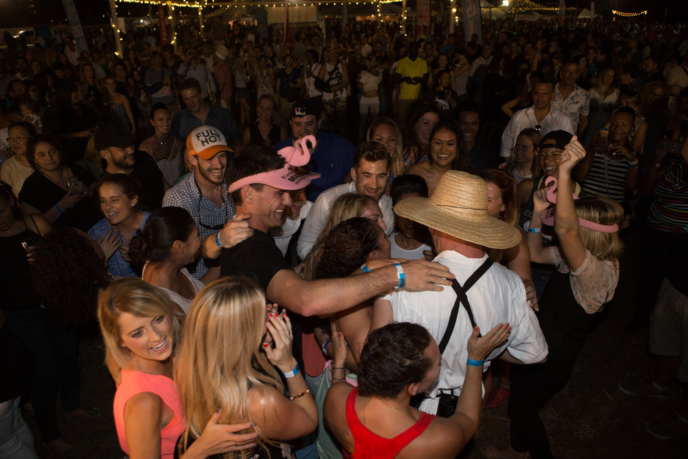 Swarmed by a flash mob of friends in a crowd of hundreds  Photo credit: Chad Munro of Picture This Studios