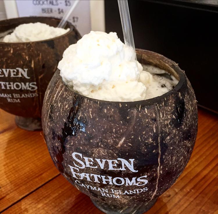 A coconut cocktail in Seven Fathom's signature coconut cup
