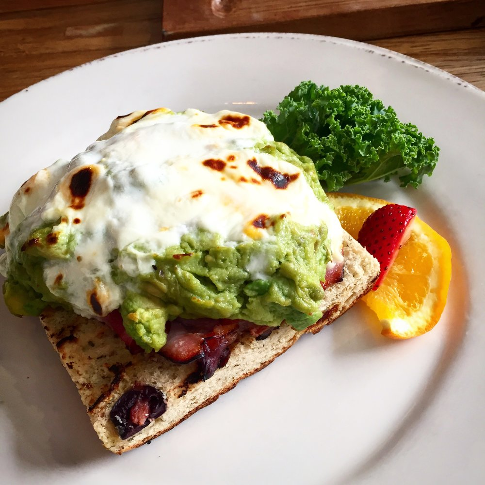"""One of the """"On Bread"""" items, the  Avocado Bake . I went for a gluten-free focaccia bread topped with crushed avocado, smoked ham and a blend of melted cheese and eggs.Dam I need this to happen in Cayman!"""
