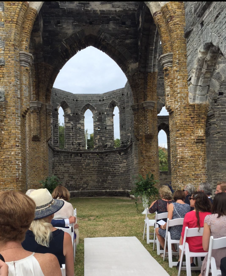 Guests waiting for the wedding ceremony to begin inside of The Unfinished Church.