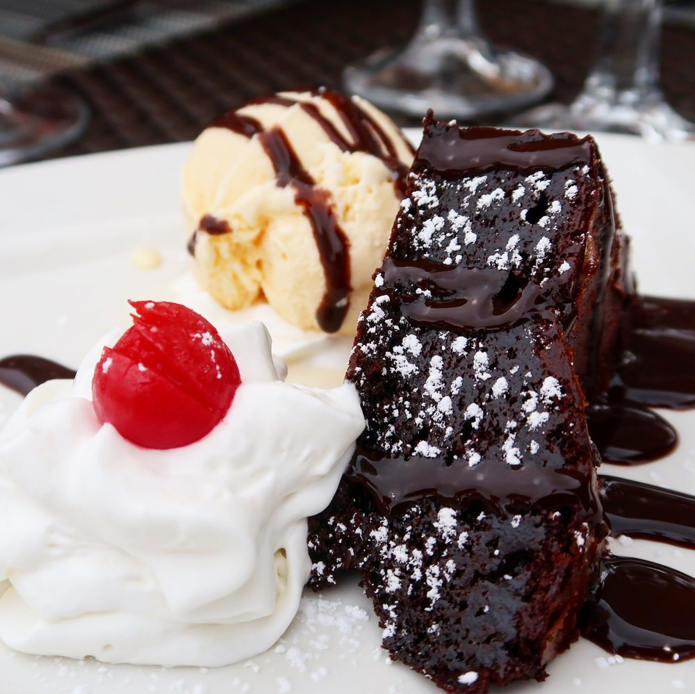 Even though it is gluten-free & nut-free this is one fudgey Chocolate Brownie; served with a scoop of vanilla ice cream.