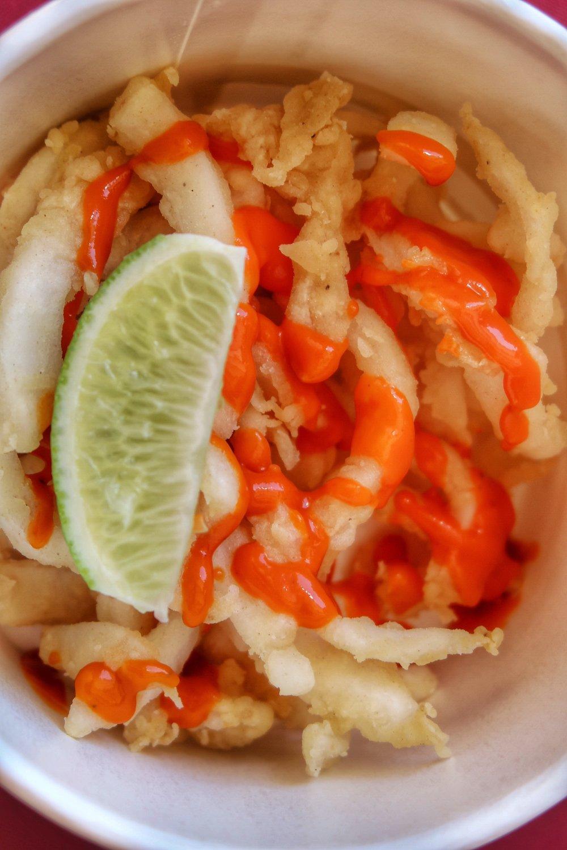 "VIVO's coconut ""calamari"" with a spicy sauce"