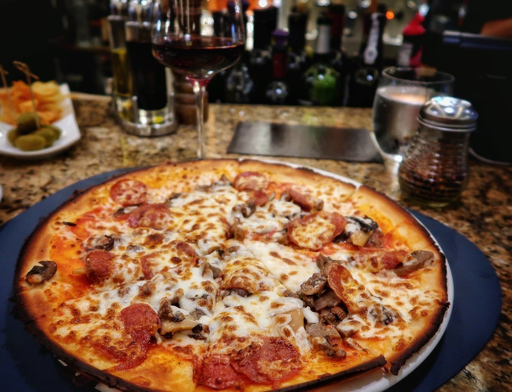 Mixed Mushroom Pizza: Tomato sauce, mozzarella cheese, porcini, champignon and chanterelle mushrooms with my addition of pepperoni. Order with gluten-free, whole wheat or regular crusts.