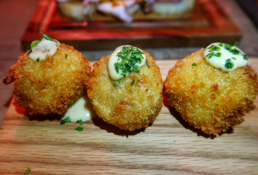 Chicken Croquetas stuffed to the brim with shredded chicken and bechamel, and topped with their addictive aioli; they practically explode with each bite!