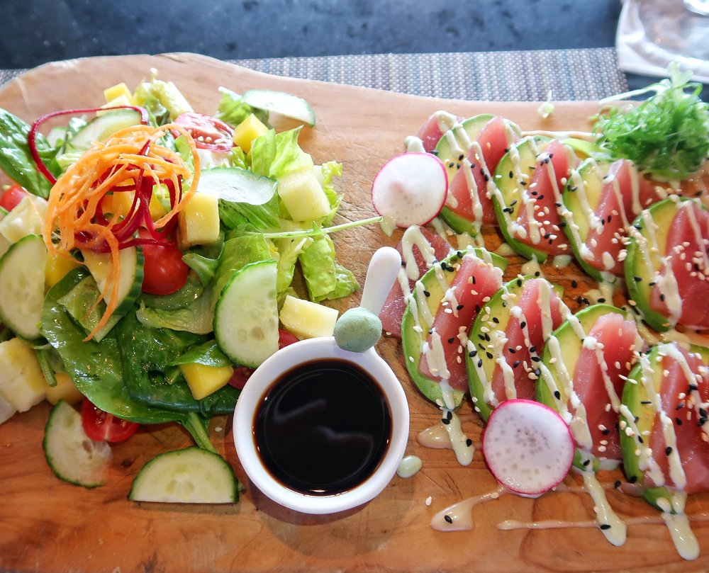 """The """"Marcus Special"""" - local tuna sashimi, avocado with sesame seeds, sesame dressing and soy sauce served with a tropical garden salad."""