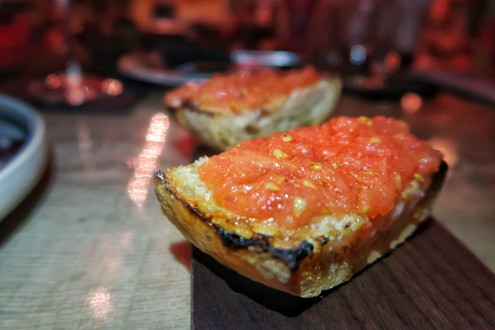 Pan Con Tomate - perfectly toasted bread topped with juicy tomatoes, olive oil, garlic & salt.  One of my favourite all-time snacks!