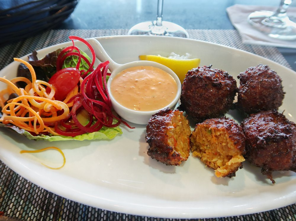 Their delicious Queen Conch Fritters filled with minced conch & vegetables served with a tangy red pepper remoulade
