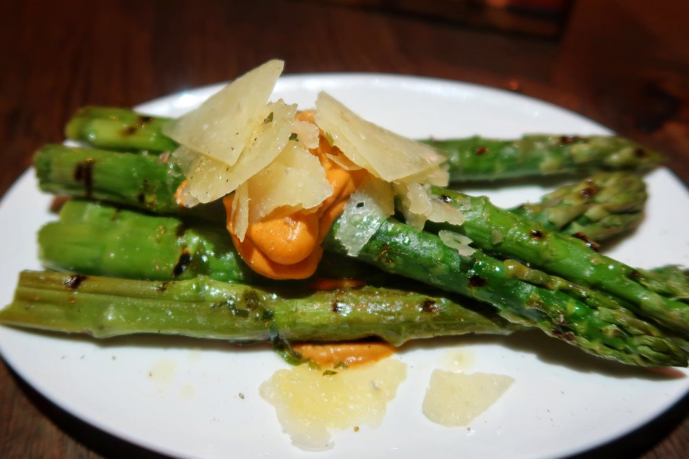 It may seem like a simple side dish, but the Asparagus with romesco sauce and manchego cheese is deeeelish!