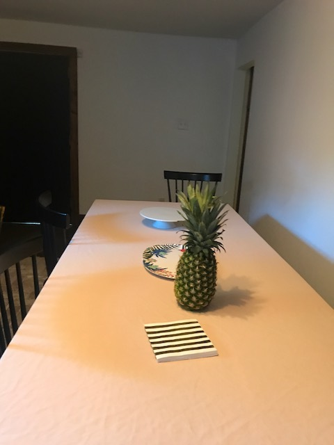 With tablecloth/sheet, pineapple and napkins