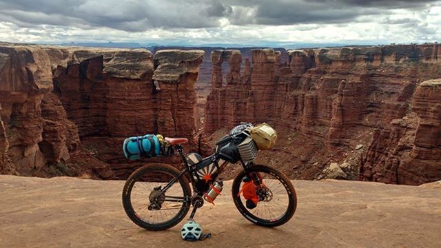 We love seeing where our customer's bikes take them! Katrina built up this customer Surly with us to tackle a bike packing trip down the Baja peninsula. She snapped this pic on a shake-down trip on the White Rim in Moab.  Send us you pics and maybe you will see them on our feed! . . #bikepacking #surlybikes #karatemonkey #whiterimtrail #moab #flagbikerev