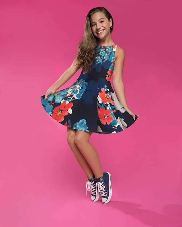 @kenzieziegler slaying the floral scuba skater dress with navy high tops = Valentine's Day perfection 💕 What's your fave #mackenzieXemilywest dress? Comment below 👇🏼 (link in bio for store locations)