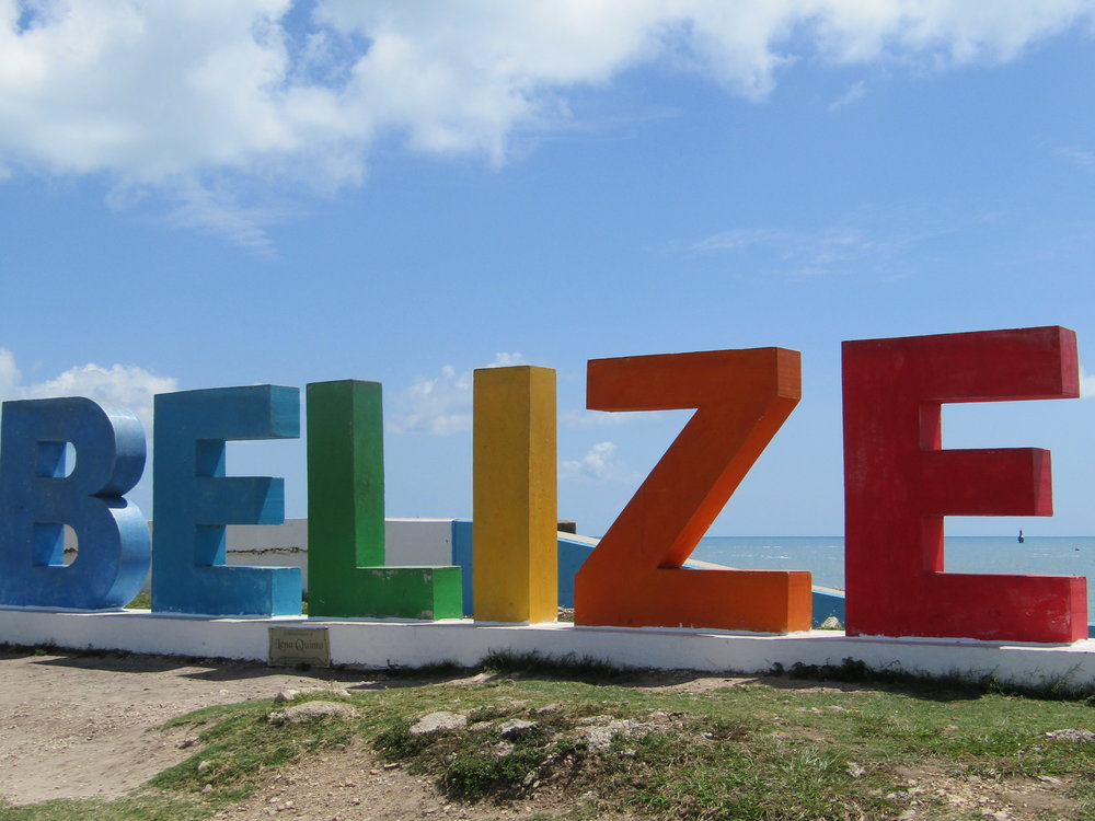 Belize sign on the shore in Belize City.