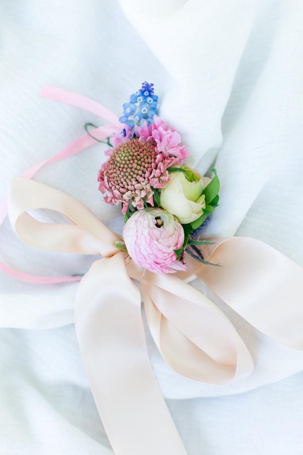 wrist corsage - seasonal blooms, greenery, tied at wrist with ribbonmedium: $45