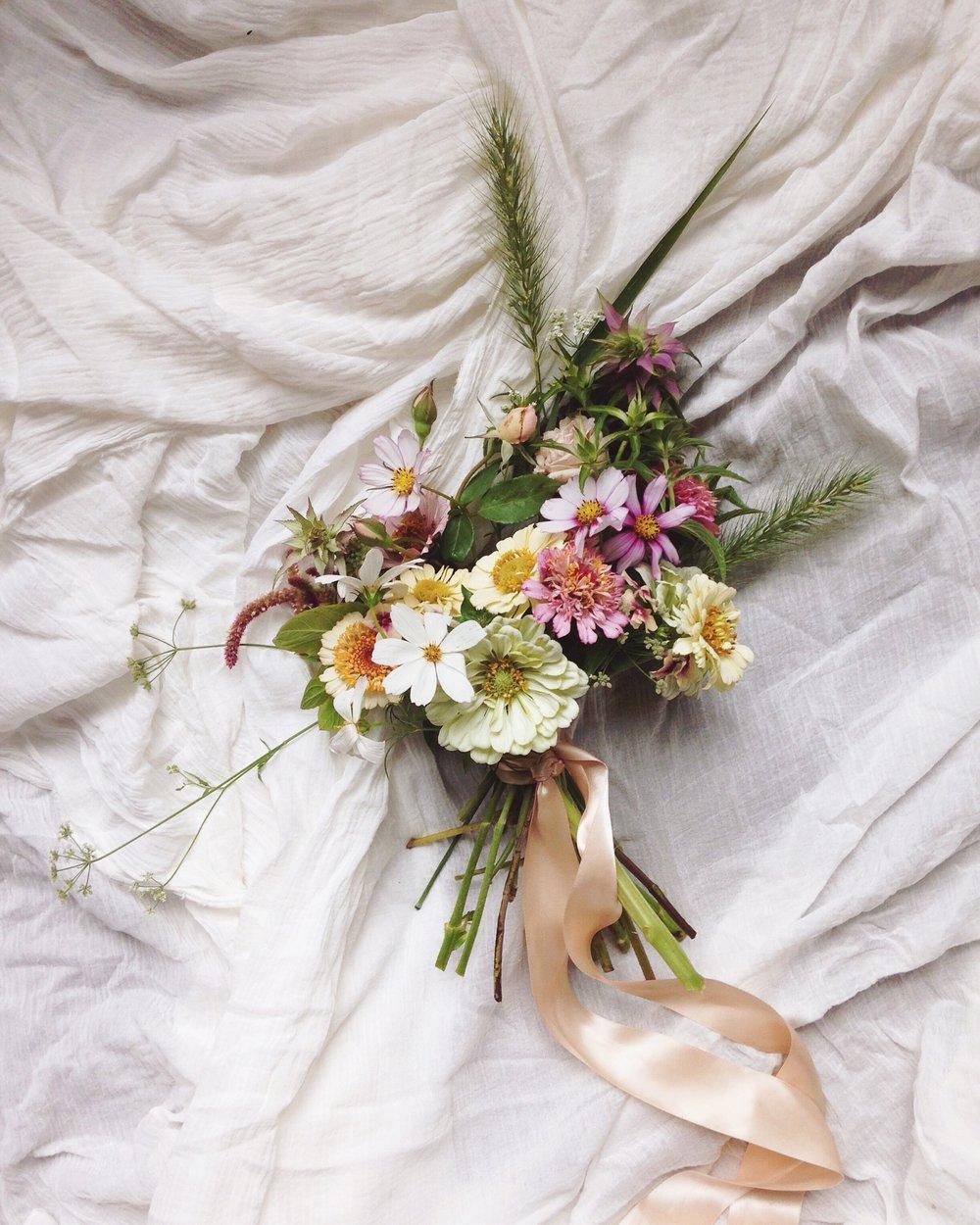bridesmaid bouquet - seasonal blooms, lush greenery, satin ribbon (upgrade to silk +$50)medium: $115small: $90