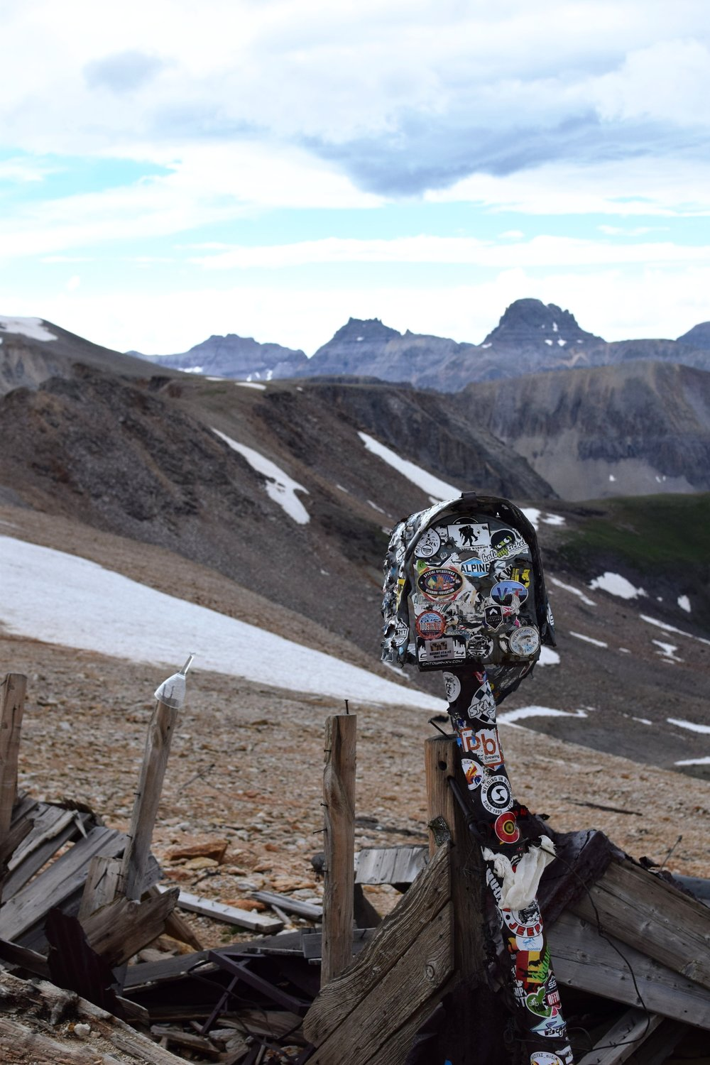 Sticker-covered mailbox at the top of Imogene Pass, 13k feet.