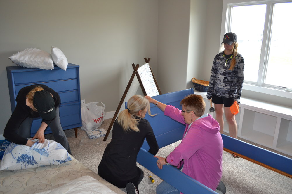 Pam and Jill helping us set up one of the bedrooms