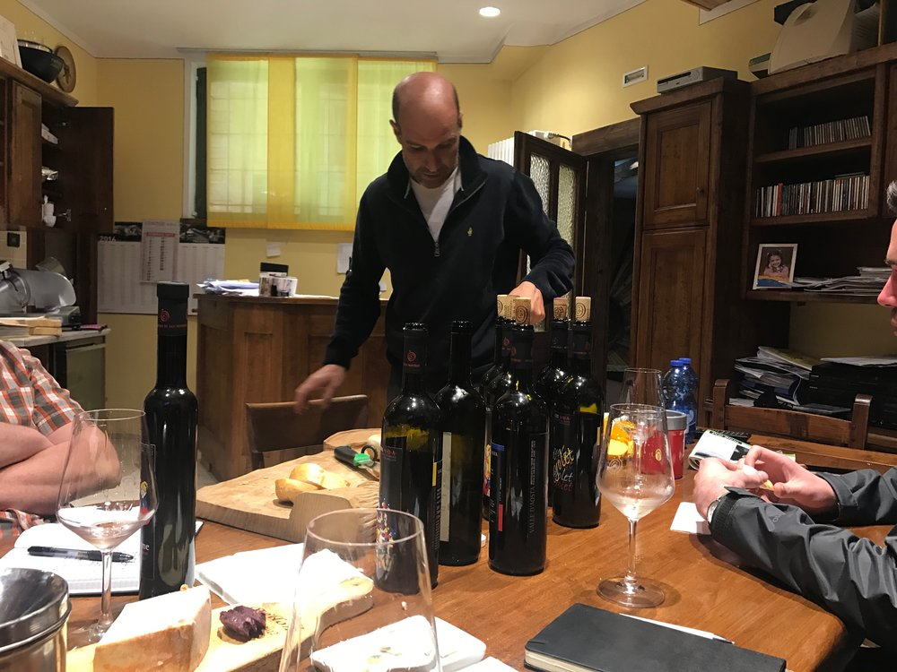 Feudo di San Maurizio - Michel Vallet pouring in the cellar.jpg