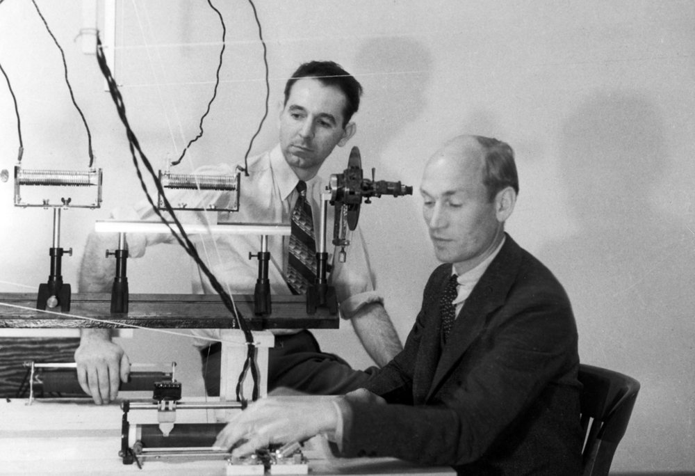 Arnold Beckman and colleague James McCullough at an optical bench, 1934.