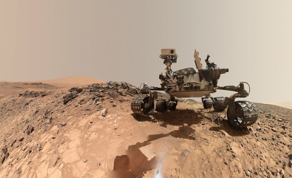 "This self-portrait of NASA's Curiosity Mars rover (created by stitching two images together and removing the rover's arm) shows the vehicle at the site from which it reached down to drill into a rock target called ""Buckskin"" on lower Mount Sharp."