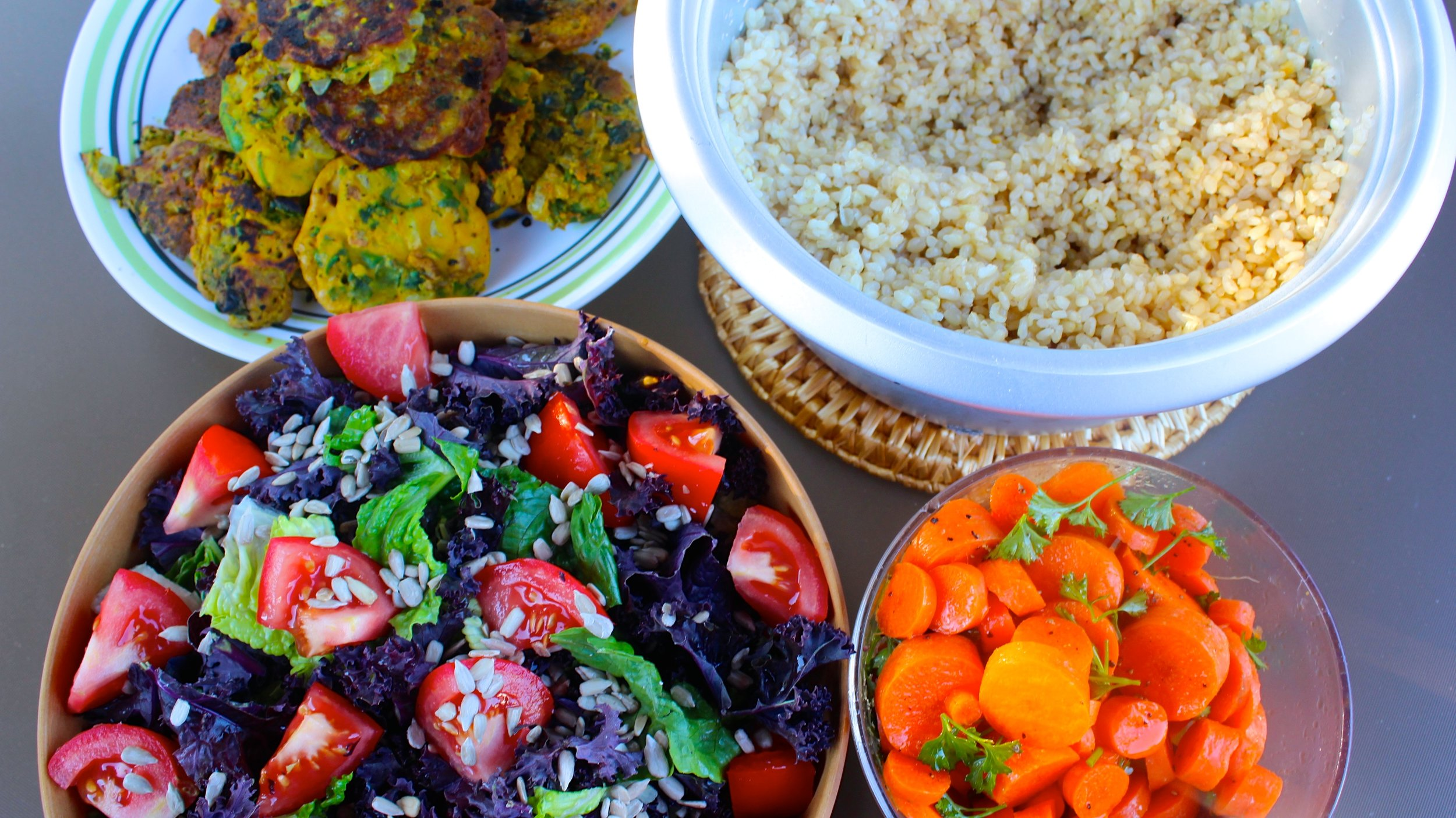 Chickpea patties, brown rice, and salads