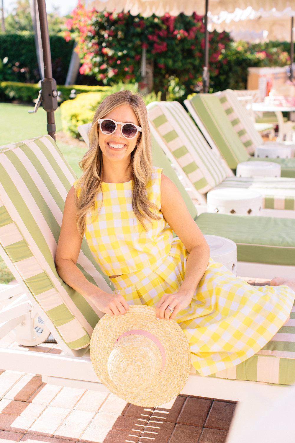 "GINGHAM LOVE   - ""The two-piece crop top and skirt in pink, mint or yellow was inspired by our love for gingham fabric and the iconic Jackie-O. We have wanted to create an updated version of this for a long time, and our new design features a fitted crop top with a gold zipper down the back and the perfect pleated skirt!""-Danielle Danielle in the"