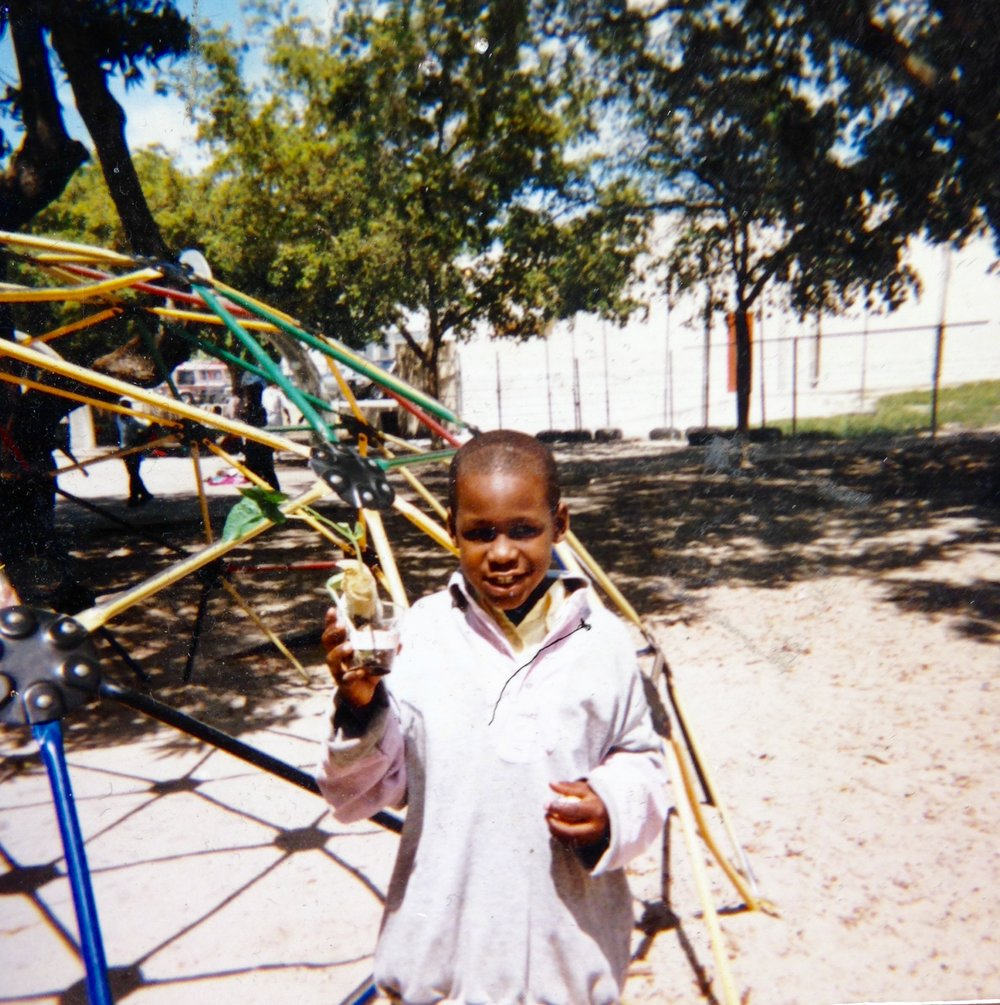 My brother outside Toussaint L'Ouverture Elementary School in Miami, Florida during the late 1990s.