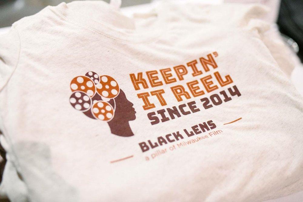 Black Lens MKE merchandise. (Picture taken by Jake Hill for Milwaukee Film Festival)