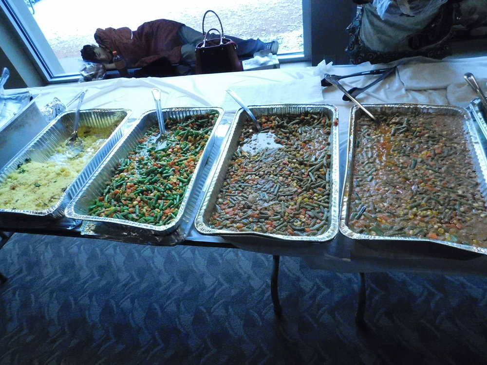 African and Jamaican dishes, such as peanut stew and rice, curry chicken, South African curry vegetables and plantain were served to community members. (Picture by Nyesha Stone)