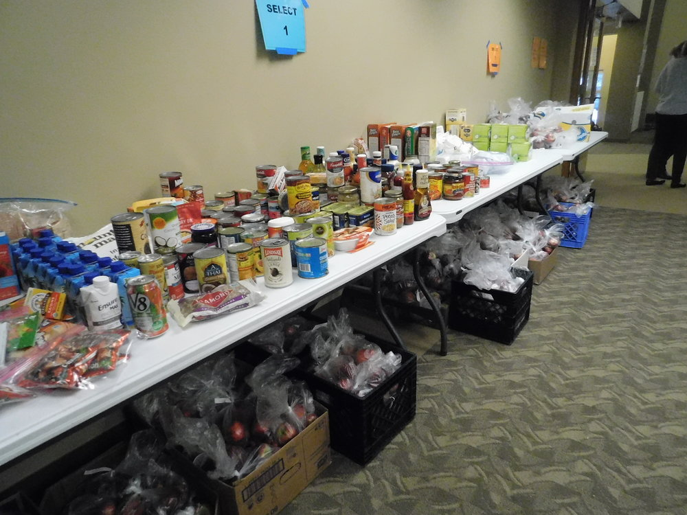 Thanks to sponsors, community members were able to take free food home. (Picture by Nyesha Stone)