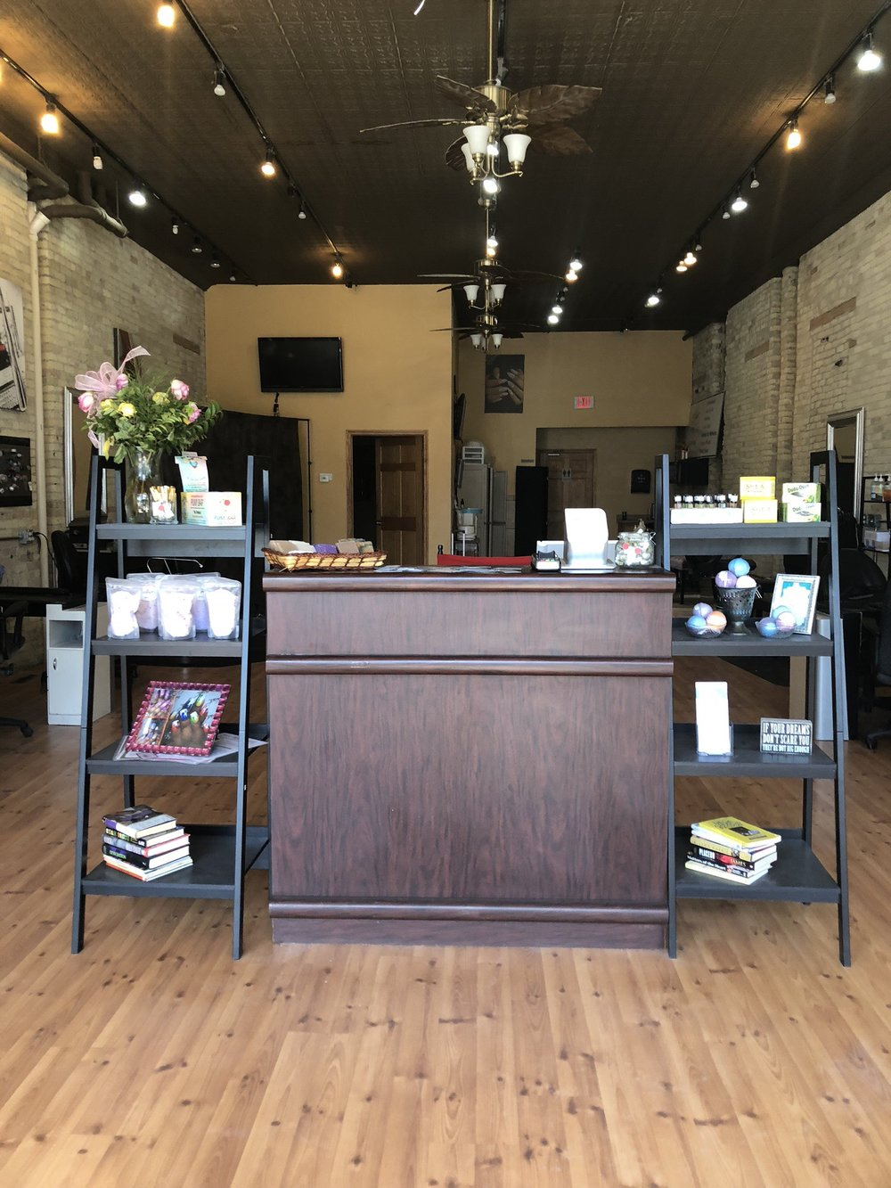 Books, business cards and lotions from different vendors around the city can be found at the front of Bijou nails. (Picture by Shotking photography)