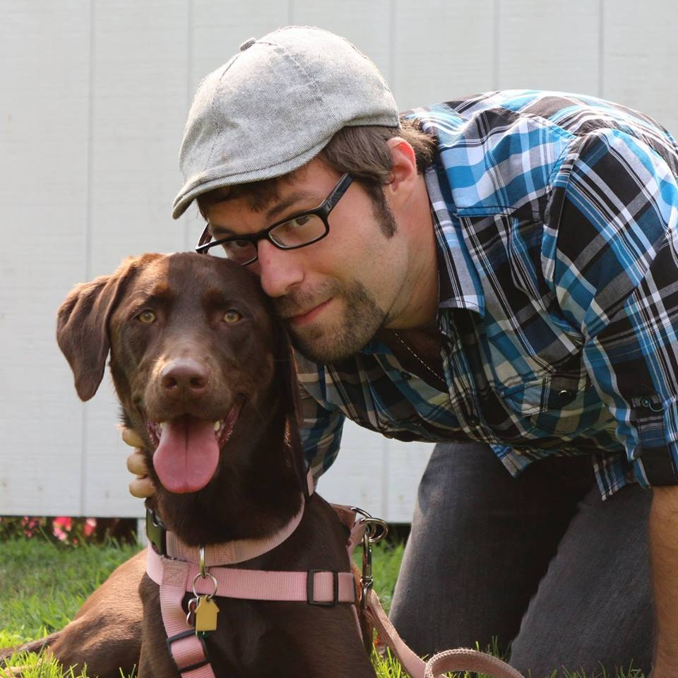 Pet Parent Marketing CEO John Scargall with his beloved Chocolate Lab, Penny.