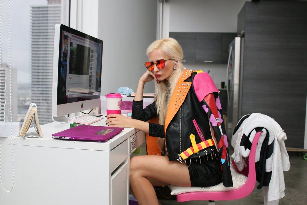 Girl at computer celebrating success