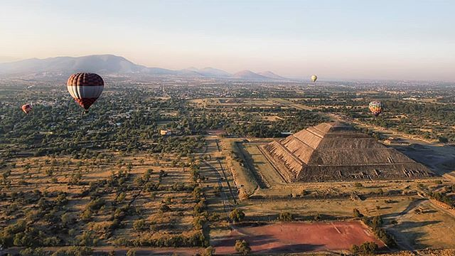 We pass over the Pyramid of the Sun as dawn breaks. Even from high, you can sense its scale – the hulking mass leaving trees cowering in shadow.  The Aztecs named this giant complex Teotihuacan, but this city housed over 100,000 people long before their time.  But one day, disaster struck. The city fell. Archaeologists have their theories, but no one knows what truly happened.  And neither shall we. The Pyramid of the Sun holds her secrets close, and we drift away. /// . . . . .  #sunshine #early #instasky #skyporn #earlybird #mothernature #all_sunsets #skylovers #instapassport #aroundtheworldpix #ig_masterpiece #campinassp #flashesofdelight #travelog #mytinyatlas #visualmobs #theglobewanderer #forahappymoment #exploringtheglobe #mexigers #primerolacomunidad #igersmexico #igersdf #wu_mexico #canonphotos #canoneos #canonrebel #canonphotographer #plethoraetc #mexico_magico
