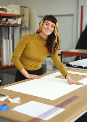 Gabrielle Roth         hinger and fitter Gabrielle, a California native, began working in fine art framing while she was a graduate student in Sculpture at Mason Gross School of the Arts, Rutgers University in New Jersey.  She brings her experience handling artworks and a passion for problem solving to each project. She enjoys the challenges that unique works of art represent and the opportunities they provide to learn new techniques. When she isn't striving to be 'fast and accurate' at DDG she runs a feral cat gang and maintains a studio practice in the Bedford-Stuyvesant neighborhood of Brooklyn.