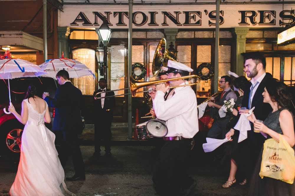 A New Orleans Second Line Parade passing in front of the famous Antoine's Restaurant. By Christie for Hi Volt Studios