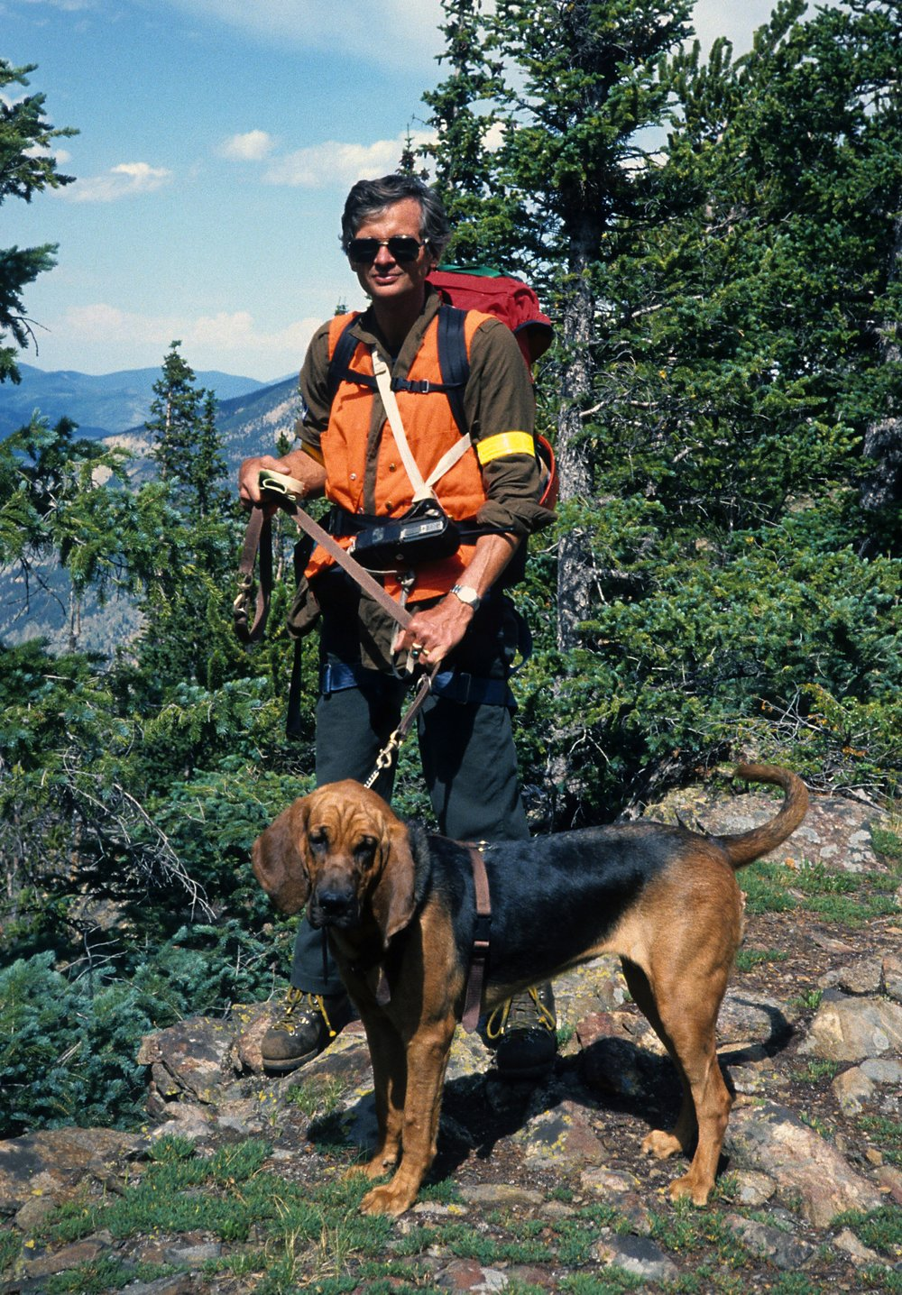 Dr. Butler and his bloodhound, Reliant, searching Pendleton Mountain in 1988