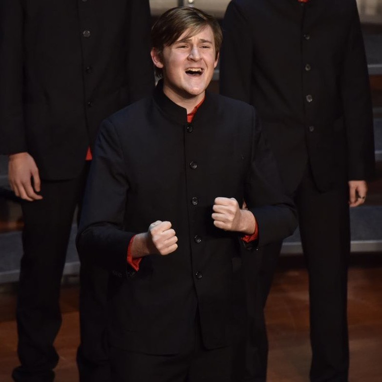 Ollie Vickers also has a passion for music; he's pictured here singing in choir and hopes to one day write his own musical.