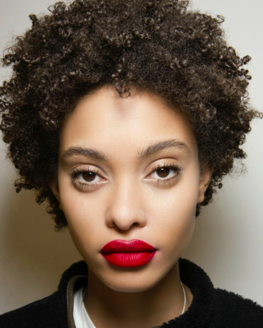 Work with your curls, not against them with this slick look.