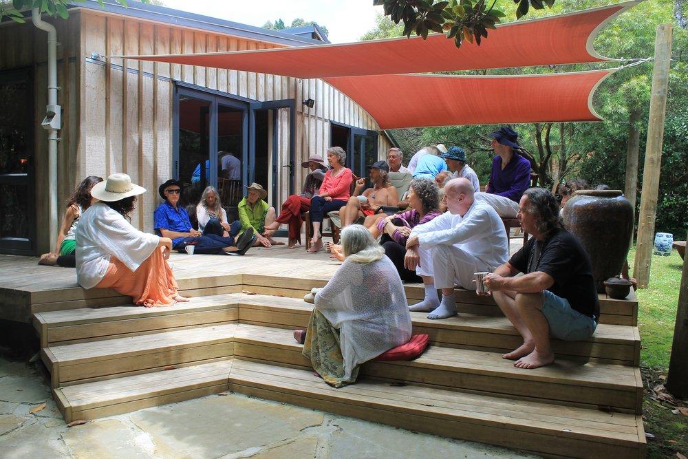<CENTRE> AROHANANDA MA SITTING WITH STUDENTS </CENTRE>