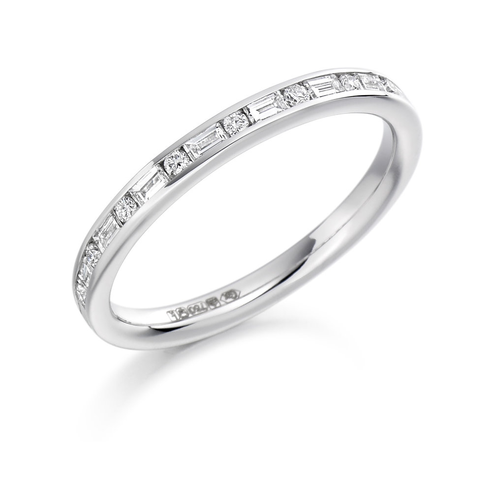 0.30ct brilliant & baguette cut diamond half eternity in 18ct gold.