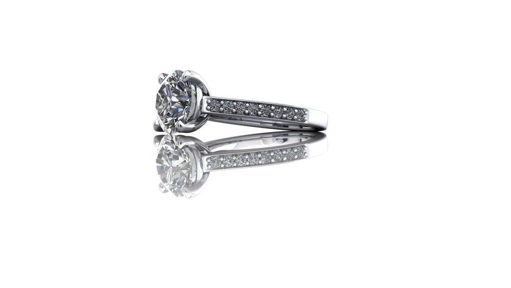 Diamond engagement ring with tapered diamond shoulders