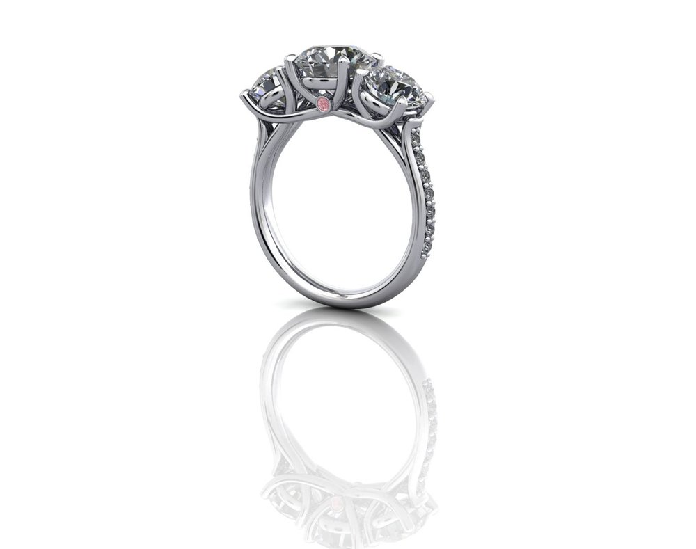 3stone diamond ring with feature pink.jpg