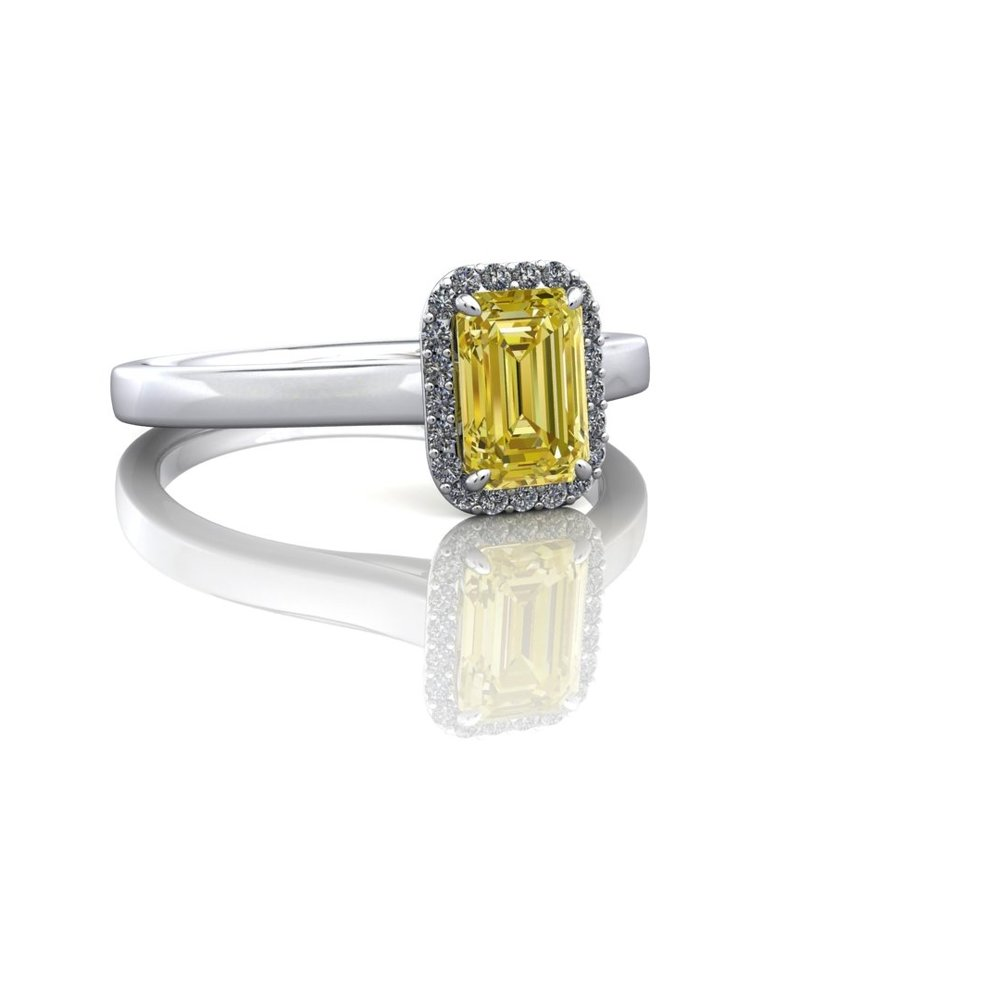 A yellow diamond in the centre with a halo. That's it. It's perfect! -
