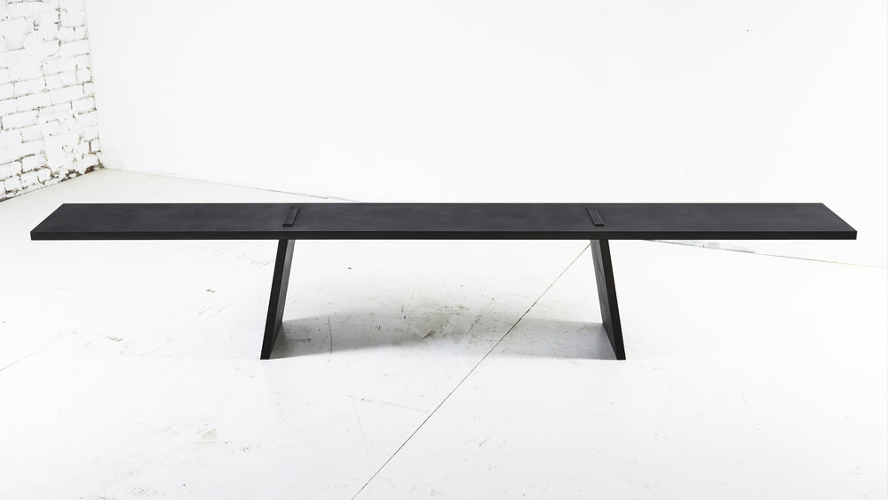 ERIC SLAYTON  Gravity Bench, 2018  Blackened and waxed steel plate  90.5 x 11 x 14.5 in